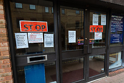 © Licensed to London News Pictures. 15/03/2020. London, UK. 'STOP' and warning signs, including cancellation of Baby Clinic on the door of Wapping Health Centre in east London. Wapping Health Centre has announced that from Monday 16th March, all new appointments at the GP surgery will be made by telephone triage only, to minimise cross infection and protect their medical workforce from coronavirus and has stated that any patients with pre-booked appointments next week should not come into the surgery but instead wait for a telephone call from their doctor. Photo credit: Vickie Flores/LNP