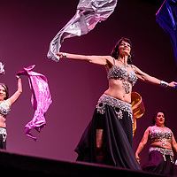 060615       Cable Hoover<br /> <br /> Members of the Saharni dance troupe wave colored scarves as they perform during the Danse De Femme belly dancing showcase Saturday at El Morro Theatre in Gallup.