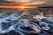January 09 - Icebergs floating around waters edge on the beach of Fellsfjara, often called Diamond beach due to the ice looking like large chunks of beautiful diamonds.<br /> <br /> Ice Beach