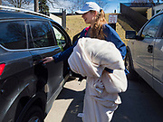 "13 MARCH 2020 - DES MOINES, IOWA: MIMI AMADEI, a first year student at Drake University, packs her car before going home for spring break. The Governor of Iowa announced Friday that 17 people in Iowa have tested positive for the Novel Coronavirus. Of those, 15 people were exposed on the same cruise in Egypt, the others were exposed through travel but were not on the same cruise. The Governor said there has not yet been any ""community spread"" in Iowa. All of the Iowans who have tested positive are in self quarantine. Across Iowa, municipalities and businesses are taking steps to implement ""social distancing."" Most of the colleges in Iowa, including Drake University, have announced that they will remain closed after their spring breaks and that classes will move to online only, after spring break. Many businesses in Des Moines, including Nationwide Insurance and EMC Insurance, have announced plans to have their employees to telecommute. The mayor of Des Moines has urged event planners to consider canceling large events.     PHOTO BY JACK KURTZ"