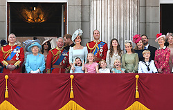 (left to right) Vice Admiral Sir Timothy Laurence, the Princess Royal, Princess Beatrice, Lady Louis Windsor, Duke of York, , Queen Elizabeth II, Duchess of Sussex, Prince of Wales, Duke of Sussex and the Duke and Duchess of Cambridge with Princess Charlotte, Savannah Phillips and Prince George, on the balcony of Buckingham Palace at Trooping The Colour, London. Photo credit should read: Doug Peters/EMPICS
