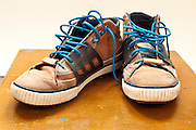 shoe sneakers with bright blue shoelaces