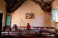 A boy stares a painting depicting baby Jesus in church in Tambura.