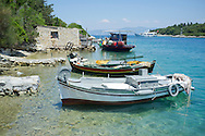 Old wooden fishing boats moored Porto Ozias on the island of Paxos, The Ionian Islands, The Greek Islands, Greece, Europe