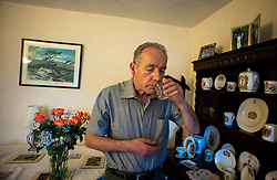 © Licensed to London News Pictures. 09/04/2014<br /> <br /> Durham, United Kingdom<br /> <br /> Parkinson's Disease sufferer David Forsyth from Brandon, County Durham takes some of the many different tablets that he needs to take each day to keep some of the symptoms of the disease under control.<br /> <br /> Parkinson's is a long-term neurological condition that affects the way the brain co-ordinates body movements including walking, talking and writing and affects both men and women.<br /> <br /> Photo credit : Ian Forsyth/LNP