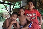 Liberto Castillo, a Ngäbe man and member of COCABO, smiles outside his home with his children. COCABO: Junquito, Almirante, Changuinola, Bocas del Toro, Panamá. September 1, 2012.