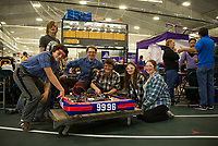 """The Interlakes """"Lakerbots"""" team readies their robot for their first time competing in the Governor's Cup FirstNH Robotics on Saturday in the All Well North complex at PSU.   Team members  Peter Borsh, Adian LeBlanc, Coach/Mentor Joe Derrick, Eli Misavage, Olivia Richards and Haley Pimley.   (Karen Bobotas/for the Laconia Daily Sun)"""