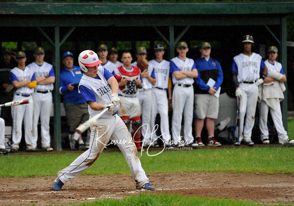Gilford's Jack McLean hits a foul tip to stay alive in the count during NHIAA division III baseball with White Mountain on Tuesday afternoon.  (Karen Bobotas/for the Laconia Daily Sun)