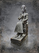 Ancient Egyptian statue of Ramesses II. granodiorite, New Kingdom, 19th Dynasty, (1279-1213 BC), Karnak, Temple of Amon. Egyptian Museum, Turin. <br /> <br /> Ramesses II is depicted in all his majesty in this ststue. He wears a Khepresh crown and holds the heqa sceptre against his chest. The statue probably belongs to the beginning of Ramesses II reign because of the presence of Queen Nefertari by the throne who died half way through his reign.