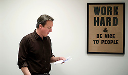 Leader of the Conservative Party David Cameron looks at his notes before delivering his speech at a rally at the Milton Keynes Academy Saturday March 27, 2010.  Photo By Andrew Parsons / i-Images.
