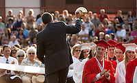 Principal Steven Beals rings the bell the final time for the 2011 Laconia High School graduating class Friday evening at the commencement ceremony.  (Karen Bobotas/for the Laconia Daily Sun)Laconia High School Graduation Friday, June 10, 2011.