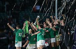 Ireland celebrate winning the Grand Slam during the NatWest 6 Nations match at Twickenham Stadium, London.