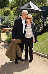 DAVID GOWER and his wife at the 2005 RHS Chelsea Flower Show on 23rd May 2005<br /><br />NON EXCLUSIVE - WORLD RIGHTS