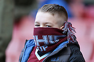 Young Burnley fan covers up from the cold  before k/o.The Emirates FA cup, 4th round match, Arsenal v Burnley at the Emirates Stadium in London on Saturday 30th January 2016.<br /> pic by John Patrick Fletcher, Andrew Orchard sports photography.