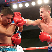 ORLANDO, FL - OCTOBER 04: Esteban Villalba (L) and Anthony Mercado trade punches during a professional super lightweight boxing match at the Bahía Shriners Auditorium & Events Center on October 4, 2014 in Orlando, Florida. (Photo by Alex Menendez/Getty Images) *** Local Caption ***Esteban Villalba; Anthony Mercado
