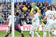 Norwich's Steven Naismith © heads the ball straight at Swansea 'keeper Lukasz Fabianski (1). Barclays Premier league match, Swansea city v Norwich city at the Liberty Stadium in Swansea, South Wales on Saturday 5th March 2016.<br /> pic by  Carl Robertson, Andrew Orchard sports photography.