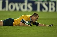 Photo: Richard Lane.<br />New Zealand v Australia. Semi-Final, at the Telstra Stadium, Sydney. RWC 2003. 15/11/2003. <br />Striling Mortlock crashes down to score his breakaway try.