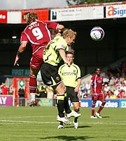 Photo: Steve Bond.<br />Scunthorpe United v Sheffield United. Coca Cola Championship. 01/09/2007. Paul Hayes (L) rises above Matt Kilgallon