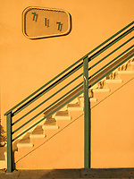 Yellow building with green stair railings