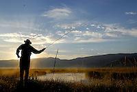 Travis Goodman of Wilson casts for cutthroat trout at sunrise. Fishing on the stretch of the creek in the National Elk Refuge openes August 1.