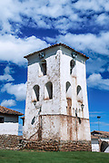 A whitewashed church is built on old Inca walls at Chincheros (30 km from Cuzco), Peru, South America. Chincheros is capital of Chincheros province in the region Apurímac, on an Andean plain at an elevation of 3762 meters.