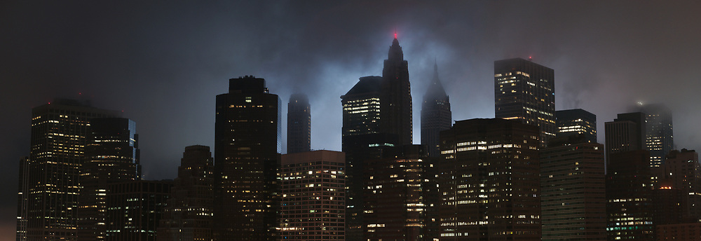 Fog covers lower manhattan and shrouds the tribute in light on the tenth anniversary of September 11th.