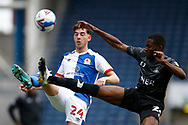 Joseph Rankin-Costello of Blackburn Rovers  and Cameron John of Doncaster Rovers contest a loose ball  during the EFL Cup match between Blackburn Rovers and Doncaster Rovers at Ewood Park, Blackburn, England on 29 August 2020.