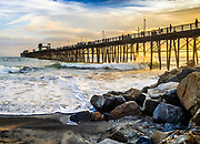 Sunset And Surfers At Oceanside Pier During Sunset