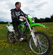 Bill Dragoo on a Kawasaki KLX-250 at Crossbar Ranch in Davis, Oklahoma