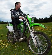 Bill Dragoo on a Kawasaki KLX-250 at Crossbar Ranch in Davis, Oklahoma