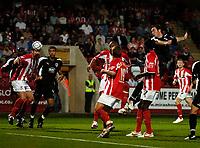 Photo: Ed Godden.<br /> Cheltenham Town v Bristol City. Carling Cup. 22/08/2006.<br /> Richard Keogh (far right) heads the ball goal bound for Bristol City.
