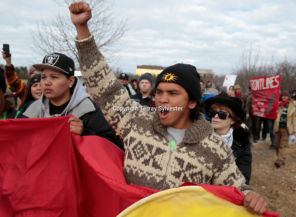 Roy Murphy of the Muckleshoot Tribe in Washington State raises a fist during a march against the Dakota Access oil pipeline on the North Dakota capitol grounds on November 14, 2016. Cannon Ball, North Dakota, United States.