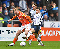 Blackpool's Josh Bowler is tackled by Preston North End's Alan Browne<br /> <br /> Photographer Dave Howarth/CameraSport<br /> <br /> The EFL Sky Bet Championship - Blackpool v Preston North End - Saturday 23rd October 2021 - Bloomfield Road - Blackpool<br /> <br /> World Copyright © 2020 CameraSport. All rights reserved. 43 Linden Ave. Countesthorpe. Leicester. England. LE8 5PG - Tel: +44 (0) 116 277 4147 - admin@camerasport.com - www.camerasport.com