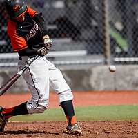 Gallup Bengal Tyler Sanchez (2) knocks away a pitch from the Bloomfield Bobcats Tuesday at Ford Canyon Park.