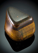 Cutout of a Tiger's Eye gemstone on black background