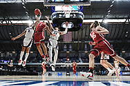 INDIANAPOLIS, IN - MARCH 22: Andrew Nembhard #3 and Corey Kispert #24 of the Gonzaga Bulldogs battle Jalen Hill #1 of the Oklahoma Sooners for a rebound in the second round of the 2021 NCAA Division I Men's Basketball Tournament held at Hinkle Fieldhouse on March 22, 2021 in Indianapolis, Indiana. (Photo by Brett Wilhelm/NCAA Photos via Getty Images)