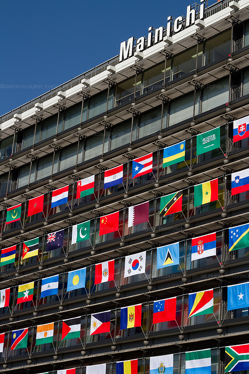The Offices of the Mainichi Newspaper Company display all 206 flags of the countries taking part in the 2020 Tokyo Olympic Games. Chiyoda, Tokyo, Japan. Friday October 27th 2017. Saturday October 28th marks 1,000 days before the opening ceremony of the Summer Olympics in Tokyo. Each flag is 210 centimeters wide and 140 centimeters high and is being draped over windows on the south side of the building, facing the Imperial Palace