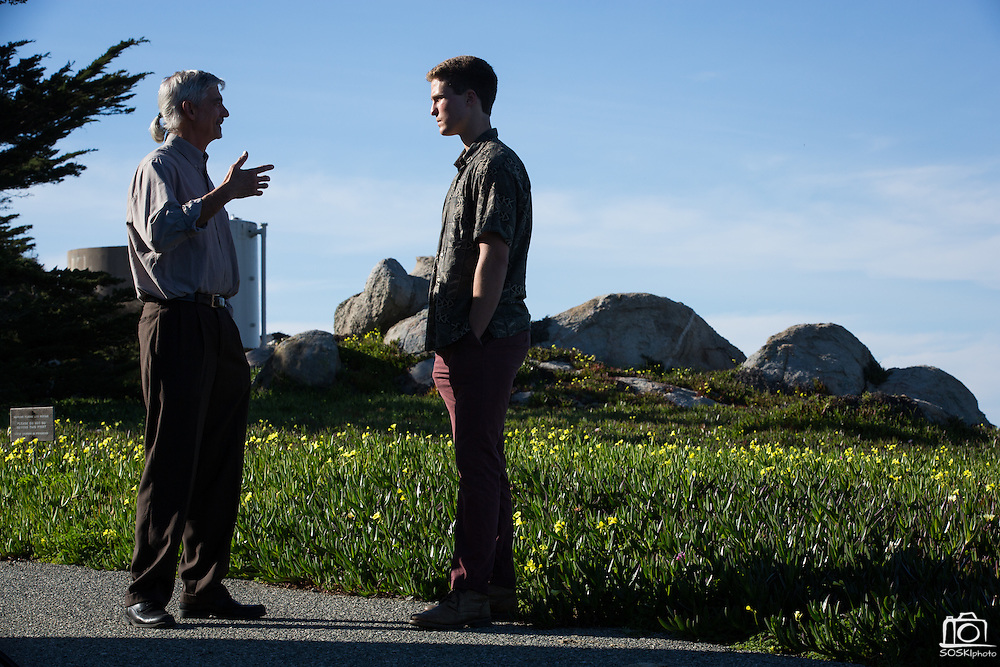 Stanford Director of Hopkins Marine Station Stephen Palumbi, left, and undergrad Austin Ayer discuss Ayer's shark fin project outside Stanford University's Hopkins Marine Station in Pacific Grove, California, on February 23, 2016. (Stan Olszewski/SOSKIphoto for Hakai Magazine)