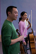 Violist Burchard Tang and cellist Priscilla Lee talk to children at the Meadowbrook School in Kingston, Rhode Island. Tang and Lee were participants in the Kingston Chamber Music Festival in 2008.