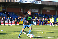 AFC Wimbledon Husuyin Biler (32) warming up prior to kick off during the EFL Sky Bet League 1 match between AFC Wimbledon and Peterborough United at the Cherry Red Records Stadium, Kingston, England on 18 January 2020.