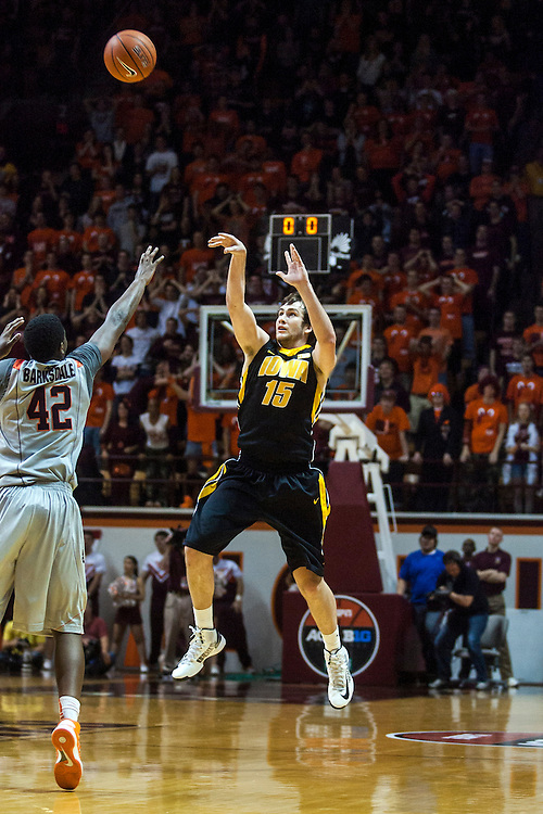Nov 27, 2012; Blacksburg, VA, USA; Iowa Hawkeyes forward Zach McCabe (15) shoots the ball in the closing seconds of the first half against the Virginia Tech Hokies at Cassell Coliseum. Mandatory Credit: Peter Casey-USA TODAY Sports