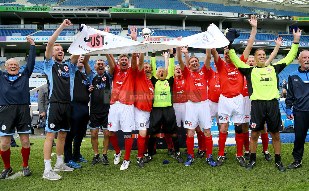 The England Over 60s celebrate victory in the Just International Cup against Italy in the Walking Football International match at The AMEX Stadium, Brighton.