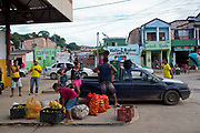 Central market and bus station in Itacare, man and son child picking up produce, Bahia, Brazil