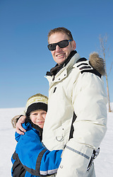 Father and son embracing, smiling, Bavaria, Germany