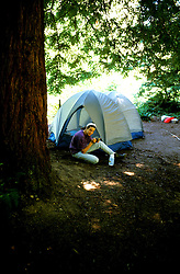 California: Camping in Big Basin, Model released..Photo copyright Lee Foster, 510/549-2202, lee@fostertravel.com, www.fostertavel.com..Photo #: cared2104