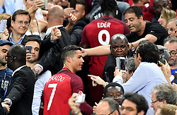 Cristiano Ronaldo of Portugal is congratulated by fans as he walks up the steps to lift the Henri Delaunay Trophy  - Mandatory by-line: Joe Meredith/JMP - 10/07/2016 - FOOTBALL - Stade de France - Saint-Denis, France - Portugal v France - UEFA European Championship Final