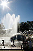 Concertgoers cool off near the International Fountain at the Seattle Center during Bumbershoot 2007.