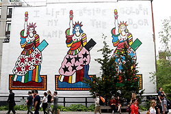 May 13, 2019 - New York City, New York, U.S. - 'I Life My Lamp Beside the Golden Door' by artist Dorothy Iannone on display along the High Line on the West Side in Manhattan.The title of the mural is the final line from Emma LazarusÃ•s poem 'The New Colossus,' the ode to the freedom promised by immigration to America engraved on a bronze plaque mounted inside the statue at Liberty Island. (Credit Image: © Nancy Kaszerman/ZUMA Wire)