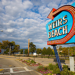 The historic Weirs Beach sign in Laconia, New Hampshire.  Lake Winnipesauke.