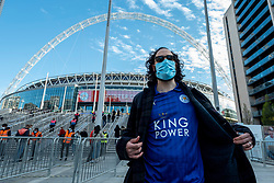 © Licensed to London News Pictures. 18/04/2021. LONDON, UK.  A Leicester City supporter outside Wembley Stadium ahead of the FA Cup semi-final match between Leicester City and Southampton.   4,000 local residents have been invited to attend the match, the largest number of spectators attending a match in a UK stadium for over a year.  Covid-19 testing will take before and after the match and data gathered will be used to plan how all sports tournaments can escape lockdown.  Photo credit: Stephen Chung/LNP